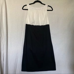 Dress with dot white pattern and back bow tie